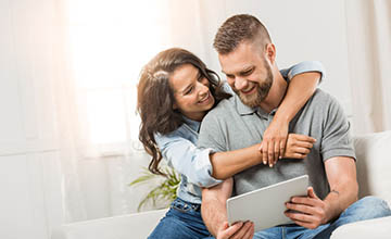 Couple looking at something on a tablet